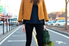 With emerald shirt, black pants, yellow jacket, green bag and ankle boots