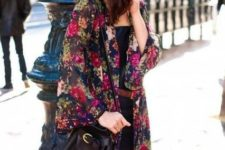 With floral cardigan, black bag and black dress