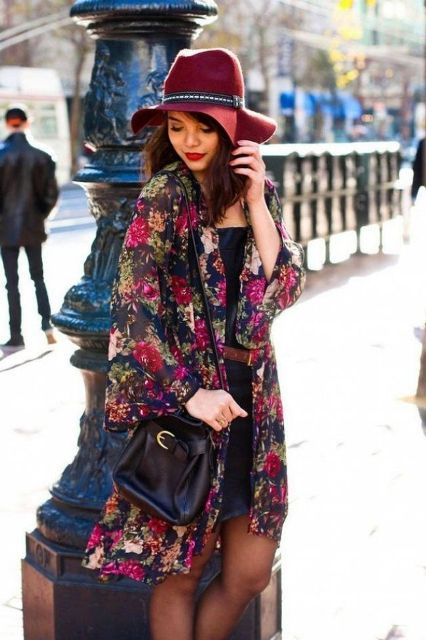 With floral cardigan, black bag and black dress