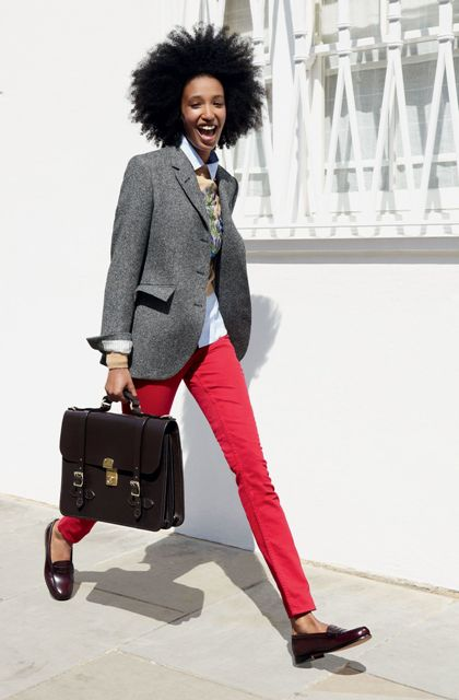 With gray blazer, black bag and red pants
