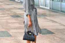 With gray coat, chain strap bag and metallic and black heeled boots