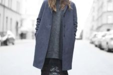 With gray oversized sweater, white sneakers and dark gray coat