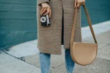With gray sweater, cropped jeans, brown flats and leather bag