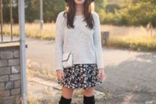 With gray sweater, floral skirt, white bag and black over the knee boots