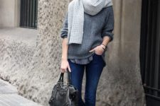With gray sweater, gray scarf, black bag and cuffed jeans