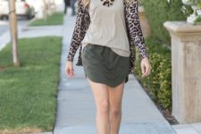 With gray top, olive green mini skirt and black ankle boots