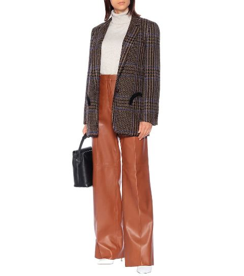 With gray turtleneck, brown high-waisted wide leg pants, printed long blazer, black bag and white high heels