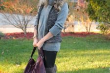 With gray turtleneck sweater, black wide brim hat, black skinny pants, gray over the knee boots and purple bag