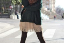 With green sweater, scarf, black tights and brown boots