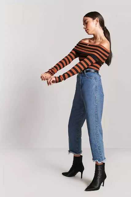 With high-waisted jeans, black ankle boots and black belt