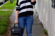 With jeans, black bag and black high heels
