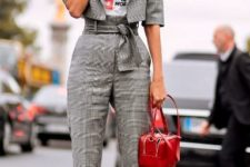 With labeled t-shirt, red bag and black pumps