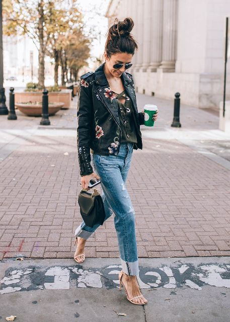 With lace up top, cuffed jeans, beige high heels and black small bag