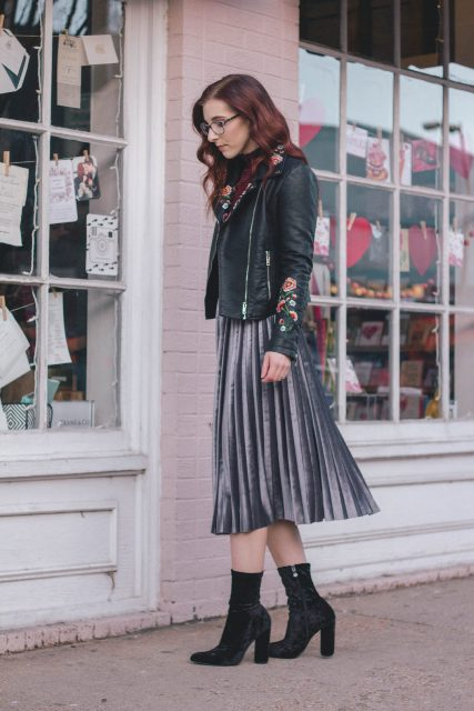 With metallic pleated skirt and black boots