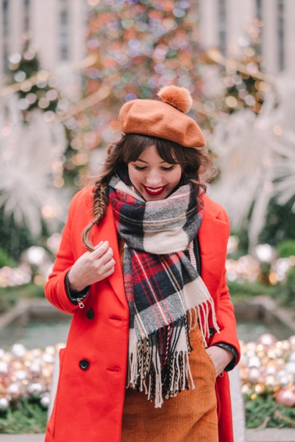 With orange dress, red coat and plaid oversized scarf