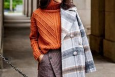With orange turtleneck sweater, printed wrapped mini skirt and over the knee boots