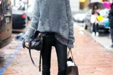 With oversized sweater, black bag, black leather pants and black heeled boots