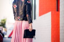 With pale pink pleated midi skirt, metallic shoes and black clutch