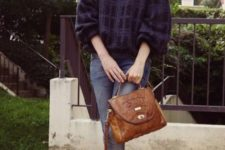 With plaid loose sweater, white shirt, cuffed jeans and brown bag