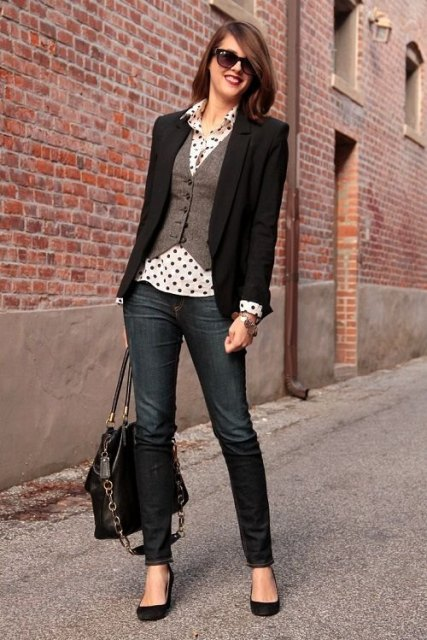 With polka dot blouse, black blazer, jeans, black bag and black shoes