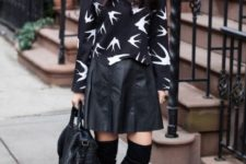With printed loose blouse, black bag and black suede over the knee boots