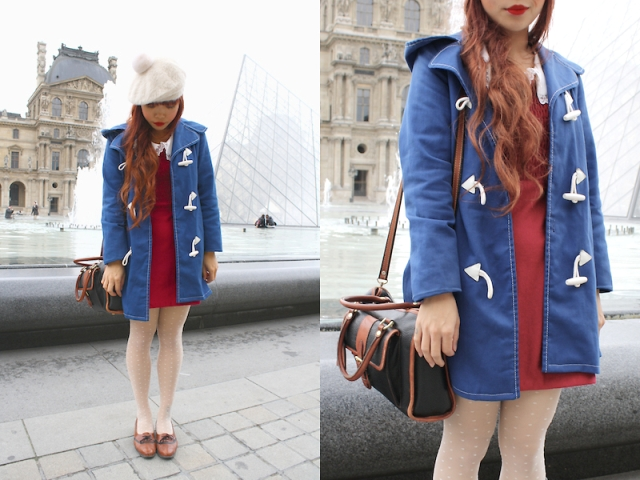 With red dress, blue coat, two colored bag and brown shoes