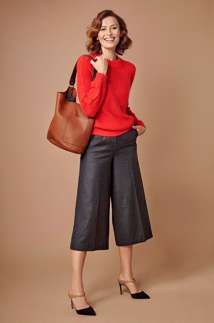 With red sweater, brown leather tote bag and black and brown heels