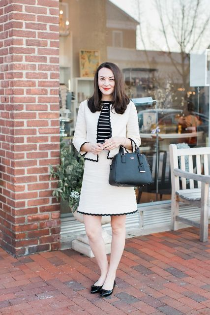 With striped shirt, black bag and black low heeled shoes