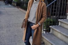 With striped shirt, brown coat, distressed jeans and clutch