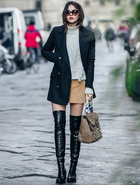 With sweater, navy blue coat, suede skirt and leopard bag