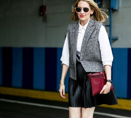 With white blouse, black pleated mini skirt and marsala clutch