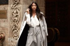 With white blouse, gray midi coat, beige bag and black shoes