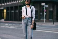With white button down shirt, black bag and high-waisted jeans