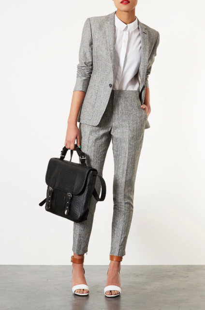With white button down shirt, black leather bag and white and brown ankle strap sandals