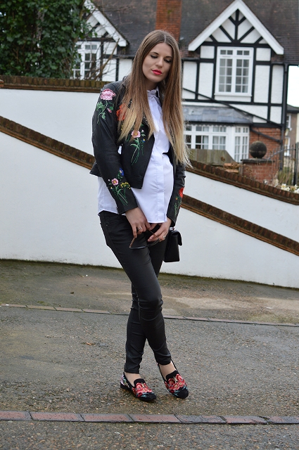 With white button down shirt, black pants, printed flat shoes and bag