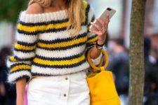 With white high-waisted skirt and yellow bag