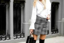 With white loose blouse, plaid wrapped mini skirt and black mini bag