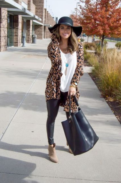 With white loose shirt, wide brim hat, leather pants, tote bag and beige ankle boots