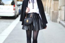 With white shirt, black blazer, wide brim hat, chain strap bag and black ankle boots