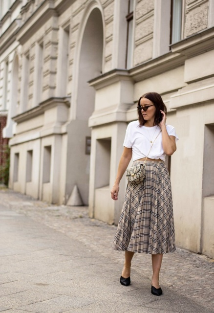 With white shirt, black mules and animal printed small bag