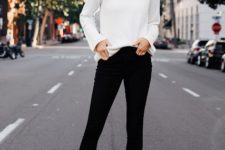 With white shirt, black skinny pants and beige boots