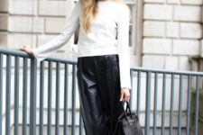 With white shirt, black wide brim hat, black bag and high heels