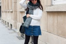 With white sweater, denim skirt, plaid scarf, black lace up shoes and bag