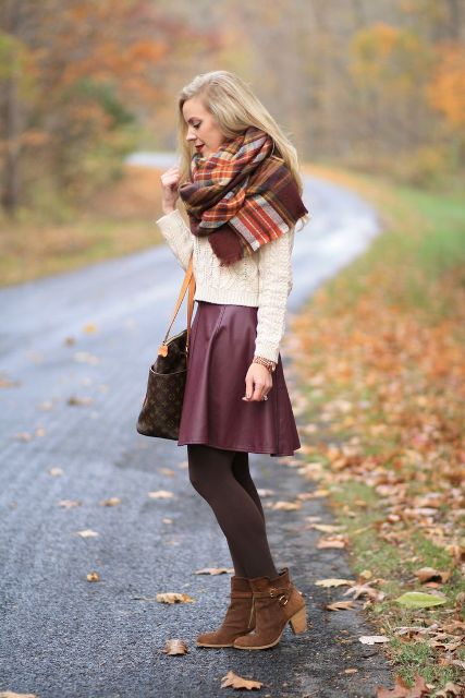 With white sweater, plaid scarf, printed tote bag and brown suede boots