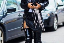 With white t-shirt, mini skirt, black leather jacket and fringe clutch