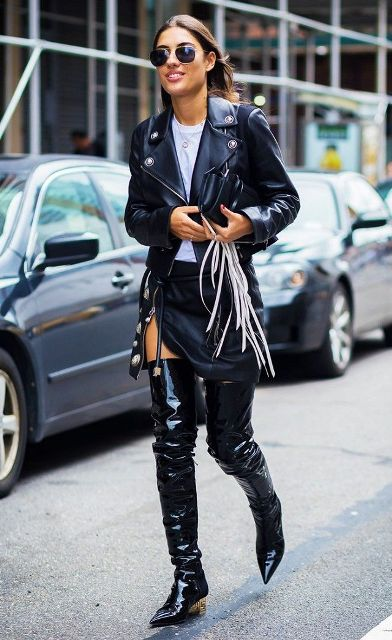With white t shirt, mini skirt, black leather jacket and fringe clutch