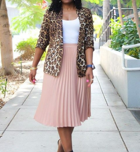 With white top and pale pink pleated midi skirt