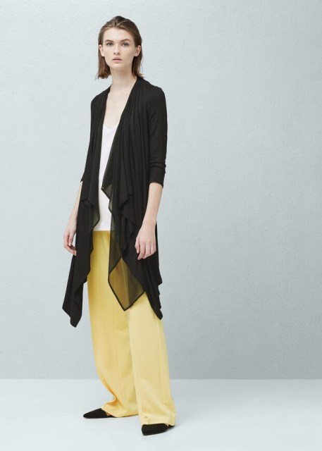 With white top, yellow wide leg trousers and black flat shoes