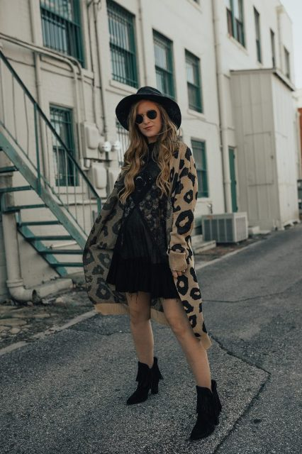 With wide brim hat, mini skirt, cardigan and heeled boots