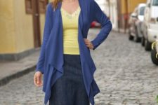 With yellow lace shirt and denim skirt